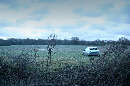 Car_in_a_field_on_bepton_road